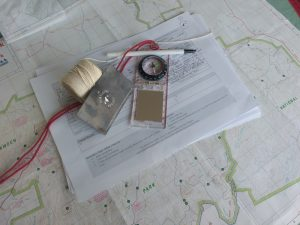 Compass, maps and navigation equipment