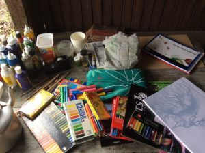 art and craft materials spread out on a table
