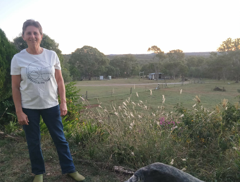 Tania stands in a farm paddock